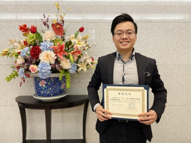 獲獎留學生之一李宣欣,與合夥人開發物流智能化系統。(記者鄭怡嫣 / 攝影)