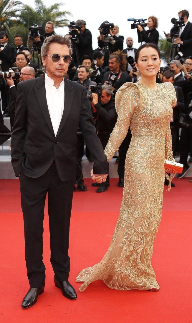 尚米歇爾雅爾與鞏俐在今年坎城影展期間手牽手看首映,已經結婚的消息也隨之公開。(圖/路透資料照片)