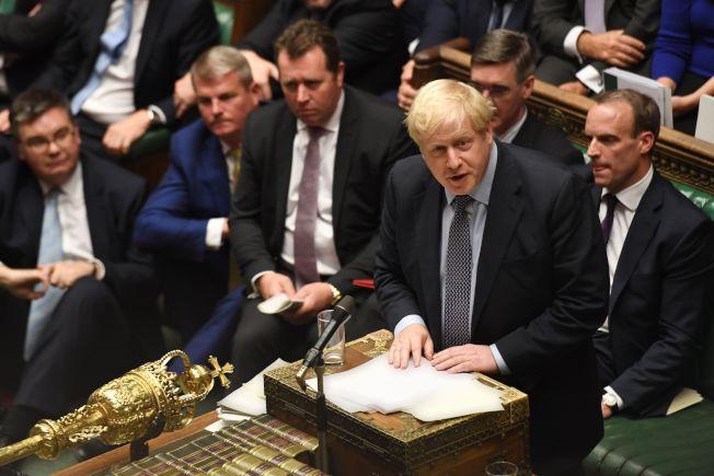 英國首相強生要贏得國會信任,還要苦戰。(Getty Images)