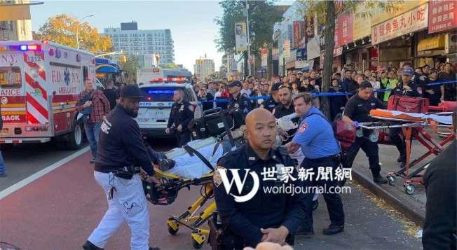 一名有精神病史的白人男子23日在法拉盛從15層高樓跳下,送醫途中不治身亡。(記者牟蘭/攝影)
