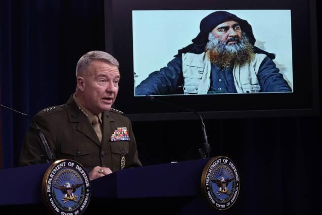 美軍中央軍區司令麥肯錫主持簡報,講述獵殺IS首腦巴格達迪的經過。(Getty Images)