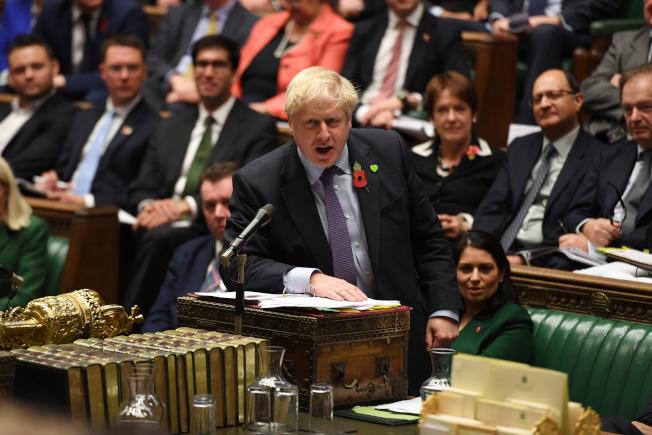 強生版脫歐協議對英國經濟傷害更大,可能讓英國經濟年損700億英鎊。(路透)