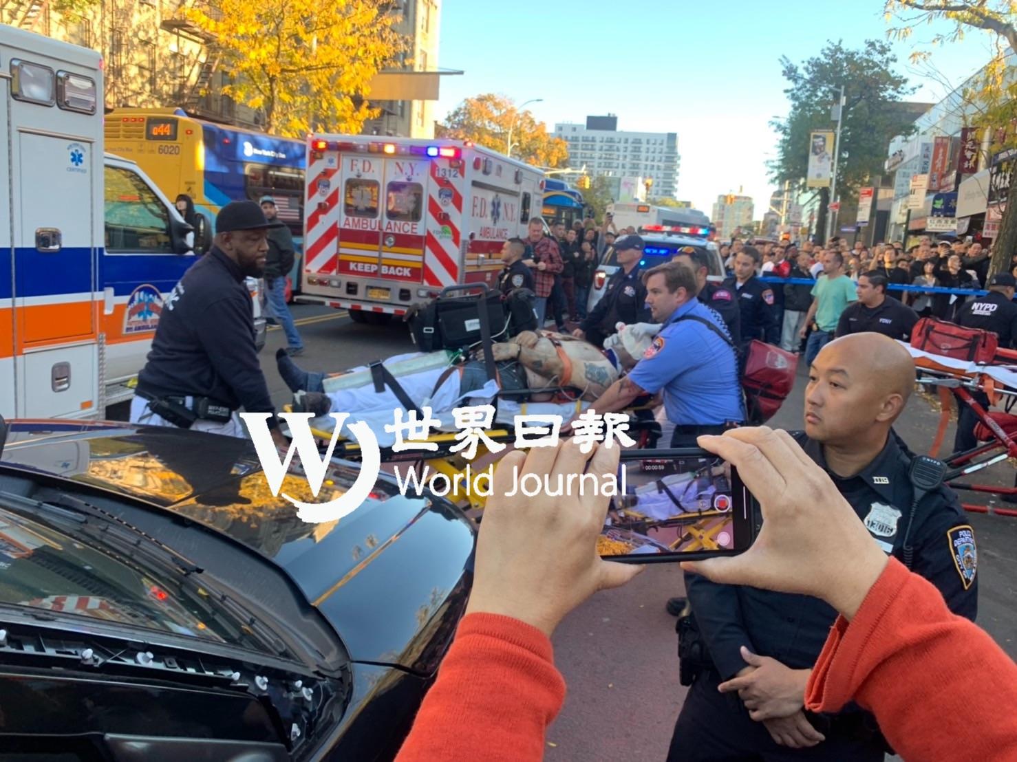 紐約法拉盛一棟大樓,樓上有民眾跳下 ,警方已趕至現場救援。記者朱蕾/攝影