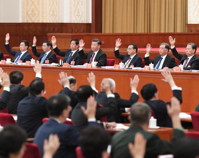 為期四天的中共19屆四中全會31日落幕,會議公報關於完善港澳「一國兩制」制度體系的論述,顯示北京當局將從法律層面緊縮對港澳的管制。(新華社)