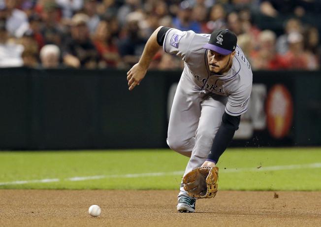 洛磯明星三壘手亞瑞納多(Nolan Arenado)再獲金手套獎,生涯已拿下七座金手套獎。(美聯社)