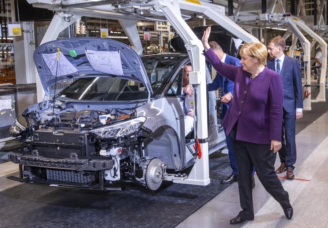 IEA估計2030年全球電動車的市占率提高到30%。(美聯社)