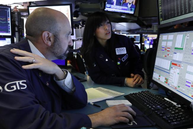 股票經紀商不再像以往那樣從近期創新高的股市交易中獲利。(美聯社)