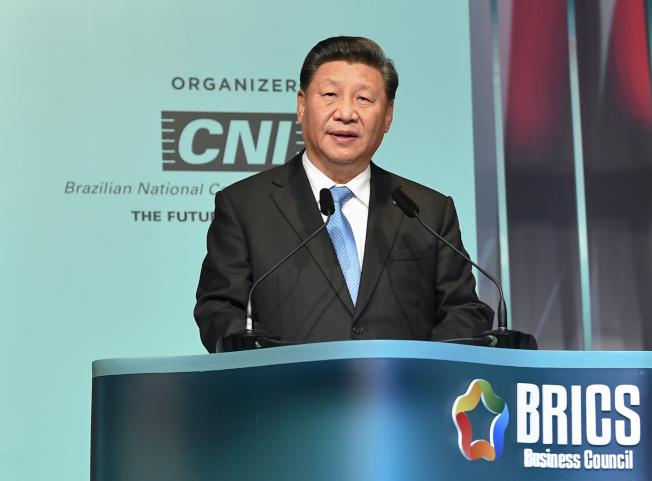 中國國家主席習近平14日說,止暴制亂是香港最緊迫的任務。圖為習近平在金磚國家工商論壇閉幕式講話。(新華社)