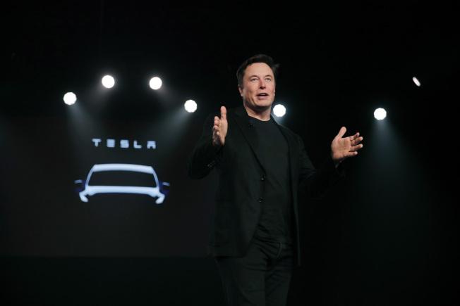 馬斯克歡迎福特加入電動車行列。(美聯社)