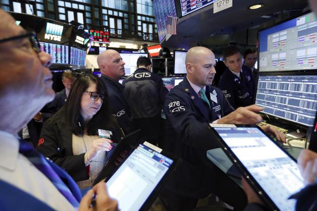 零售股帶動,股指再升至新的紀錄高位。(美聯社)