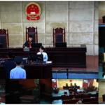 中媒公布「假共諜」王立強在中國詐騙案受審畫面