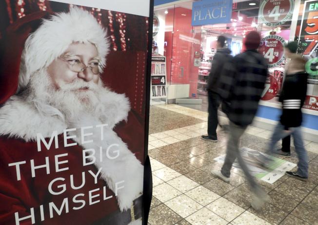 在威斯康州的一處購物中心,可以聽到耶誕老人的腳步近來。(美聯社)