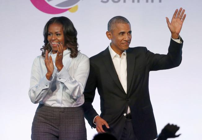 前總統歐巴馬夫婦。美聯社