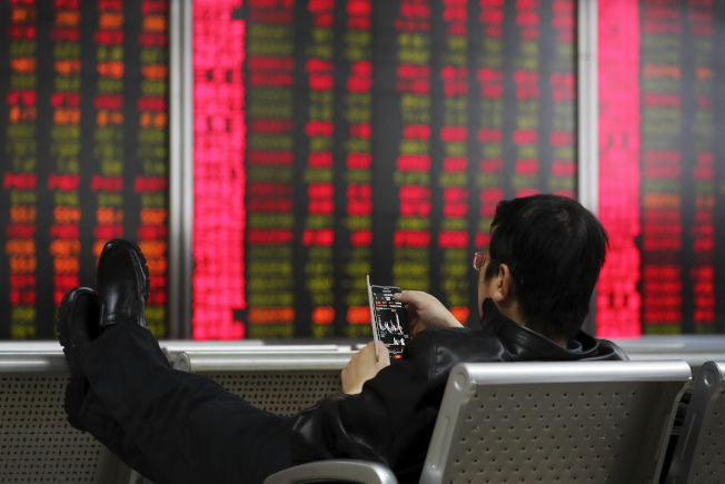 中國股市若能再國際化一點會更好。(美聯社)