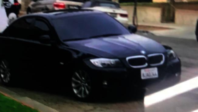 竊賊駕駛的黑色寶馬轎車。(蒙市警局提供)