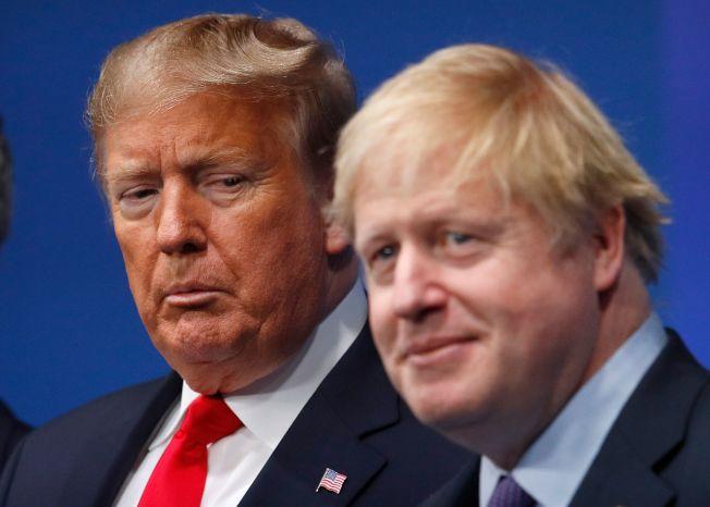 英國首相強生帶領的保守黨在國會選舉大勝,對美國總統川普明年連任是好兆頭?圖為強生(右)和川普12月4日在倫敦出席北約高峰會。(Getty Images)
