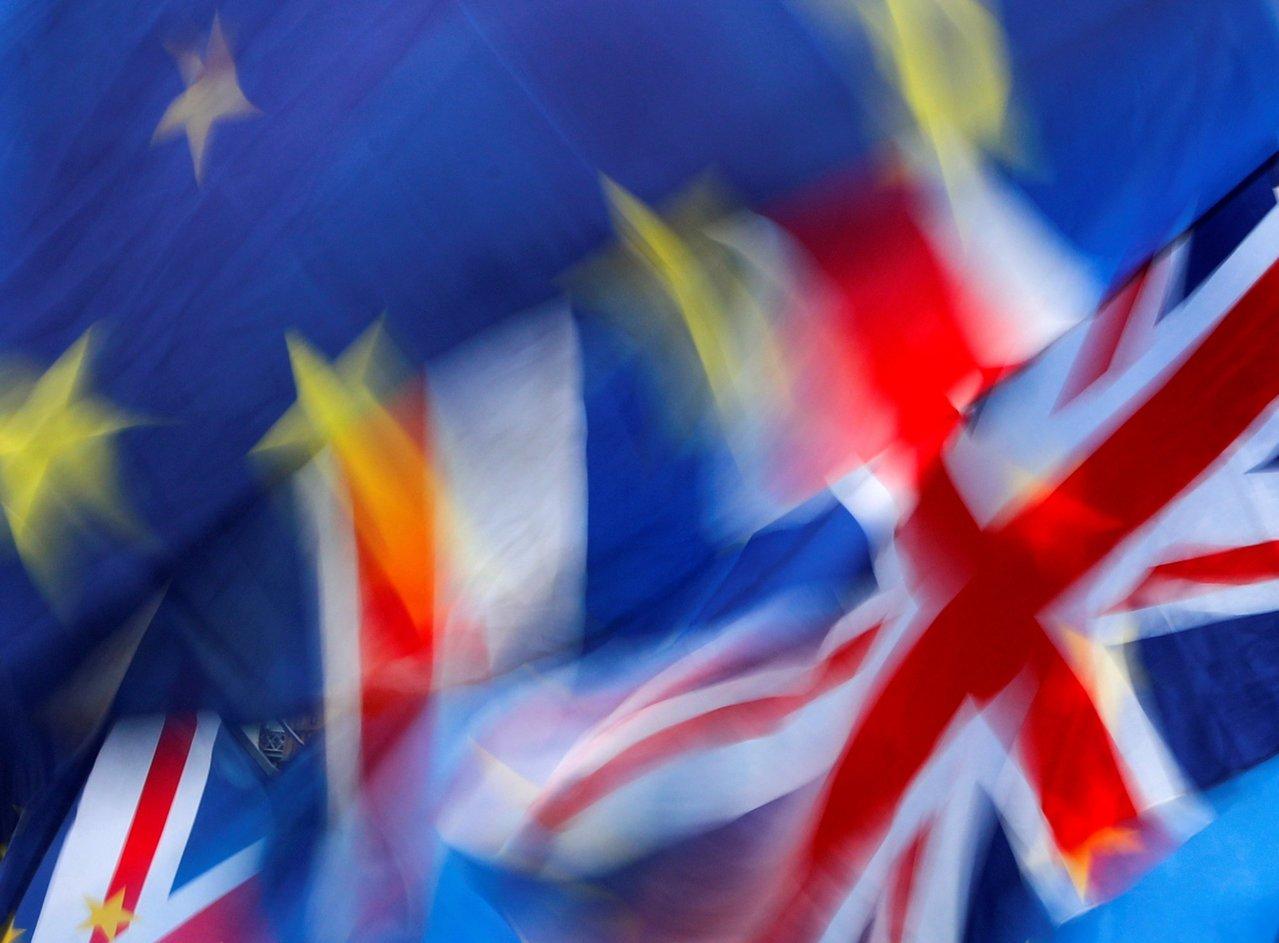 英國12日舉行國會大選。 路透