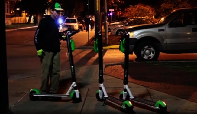 有專人管理的電動滑板車站。(截自視頻)