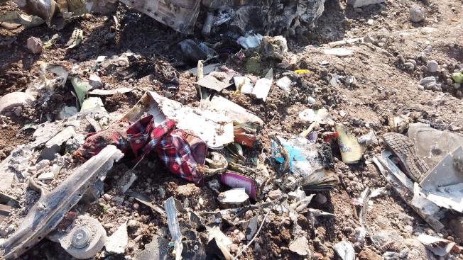 烏克蘭波音737民航客機8日遭到伊朗誤擊,墜毀在德黑蘭郊區,遺骸散布地面,各界嚴辭譴責,加拿大等國12日舉行悼念儀式為罹難者祈福。(路透)