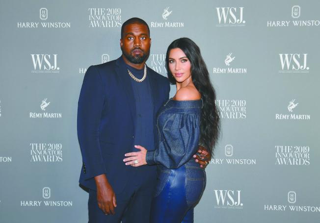 饒舌歌手肯伊威斯特與妻子實境秀女星金卡達夏。(Getty Images)