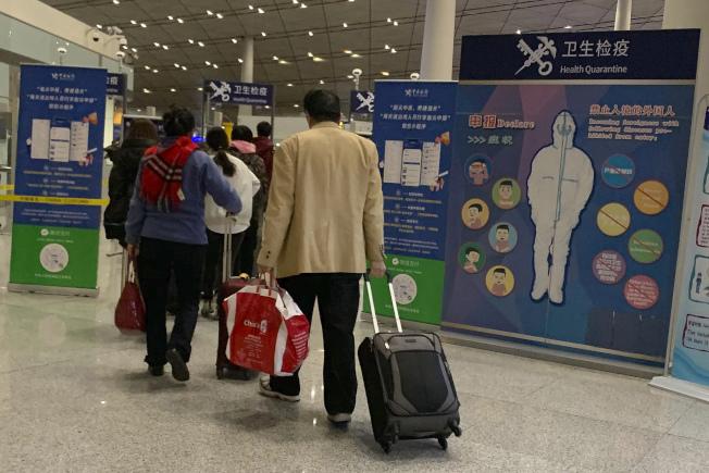 武漢爆發新型冠狀病毒肺炎病例後,中國及鄰國已加強檢疫,預防疫情擴大。(美聯社)
