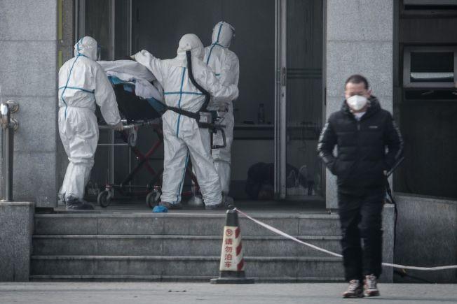 圖為武漢18日的新型冠狀病毒病例集中在湖北武漢市金銀潭醫院接受治療。(Getty Images)