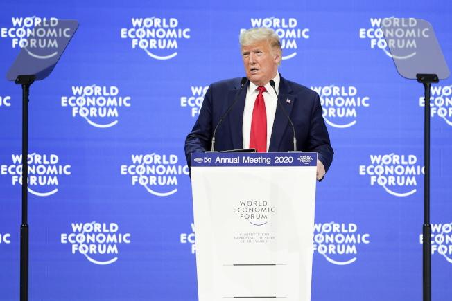 美國總統川普21日出席達沃斯會議。(圖/歐新社)