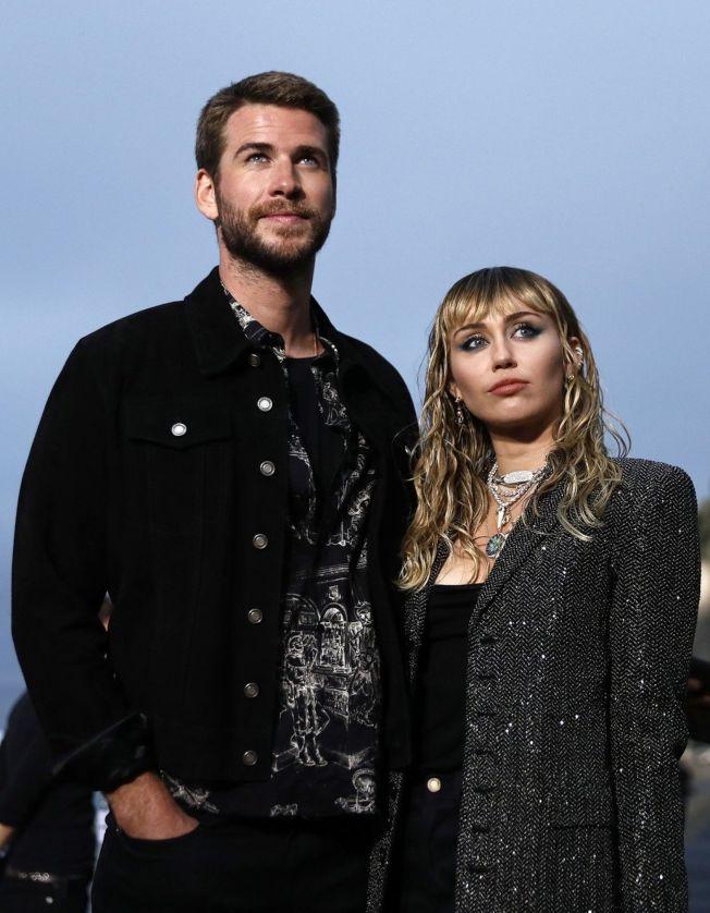 連恩漢斯沃(左)與麥莉離婚後,各種傳聞仍不斷。(歐新社資料照片)
