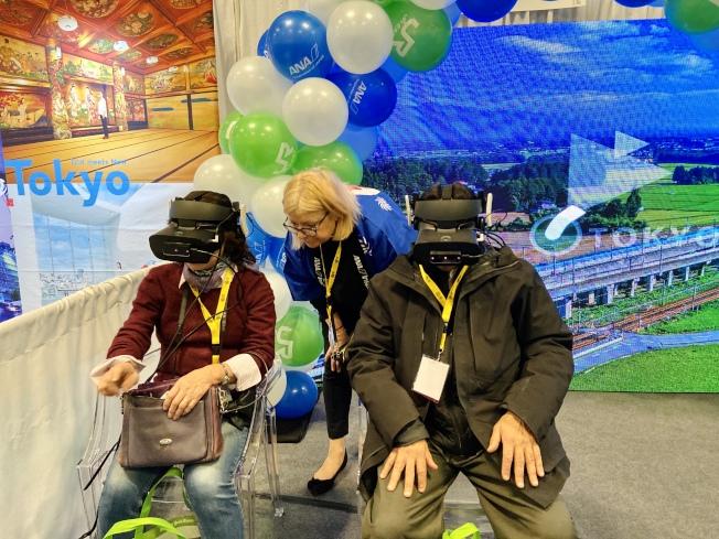 日本展位可體驗虛擬技術,體驗搭乘商務座的感覺。(記者鄭怡嫣/攝影)