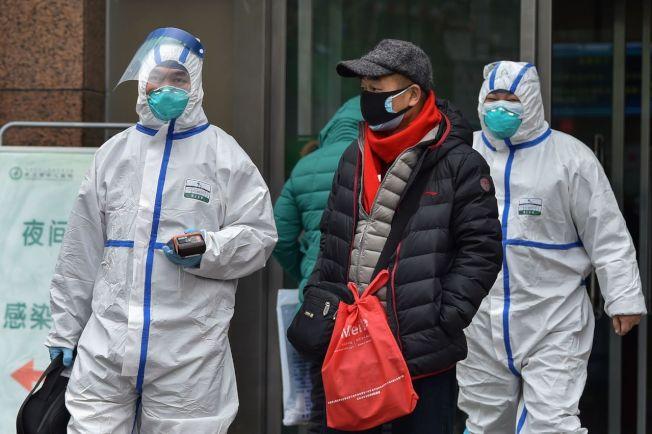 武漢肺炎持續擴散,截至26日中國官方公布累計確診病例約2000例,死亡50餘人。 圖╱GettyImages