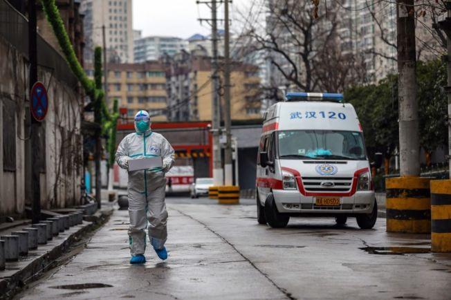 武漢封城,除了防疫人員,大街上空無一人。(歐新社)