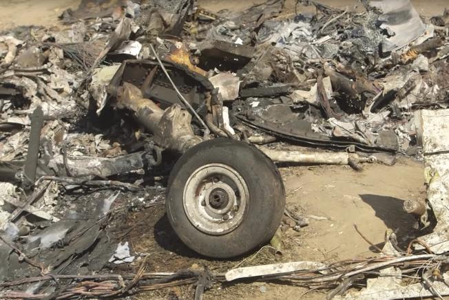 圖洛杉磯湖人隊傳奇球星柯比‧布萊恩特機墜機現場,機身殘骸四散。(美聯社)