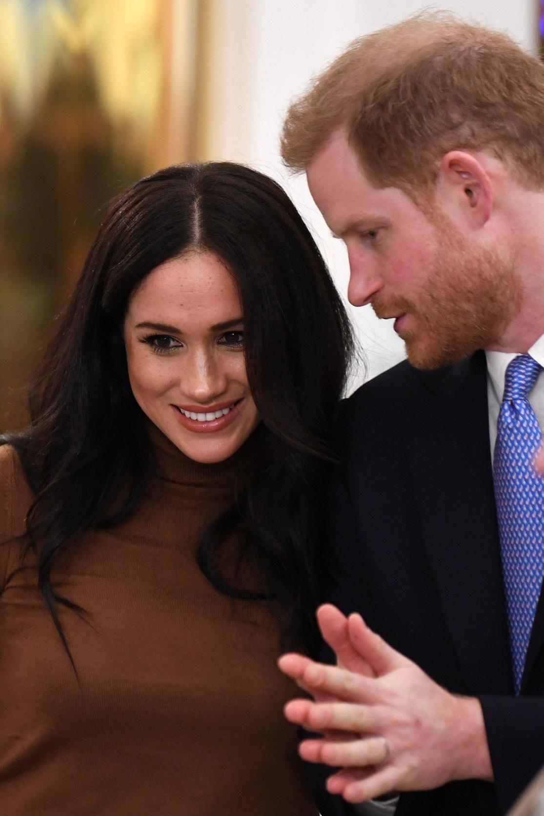 哈利王子(右)與梅根將不再使用王室「殿下」頭銜,也不再領取用來履行職務的公帑。(Getty Images)