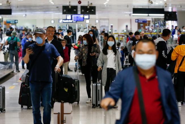 受疫情影響,南加州與中國有連結的快遞業、採購業、教育等行業,面臨著不同程度的挑戰。(歐新社)