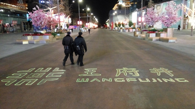 擔心被感染,很多人不出門了,即使以往熱鬧的北京王府井街也幾乎沒遊客。(中央社)