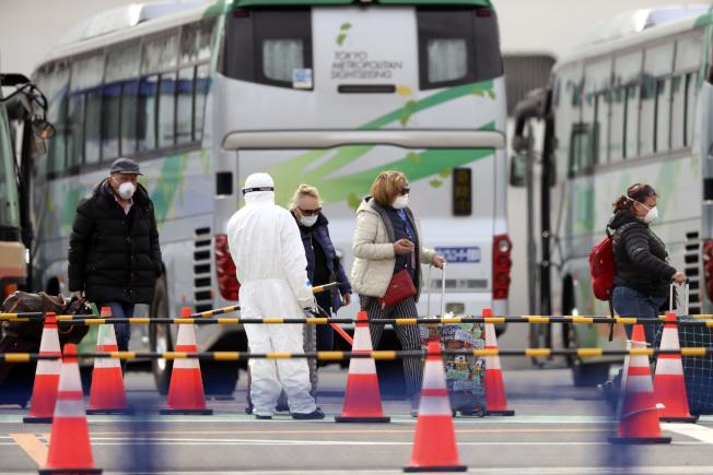 日本因新冠肺炎確診病例猛增,被美國CDC列為新冠病毒一級警示區。(美聯社)