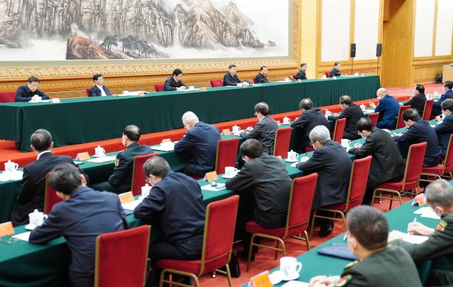 2月23日,統籌推進新冠肺炎疫情防控和經濟社會發展工作部署會議在北京召開。(新華社)