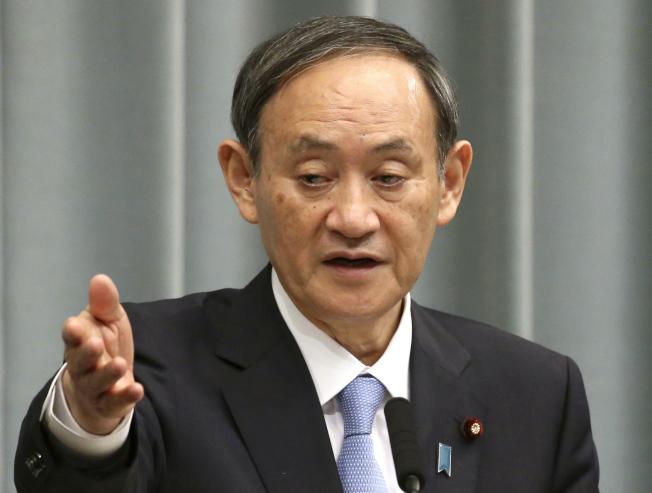 菅義偉表示,儘管新冠病毒疫情蔓延,但國際奧委會和東京奧組委仍在按計畫推進東京奧運會的準備工作。(美聯社)