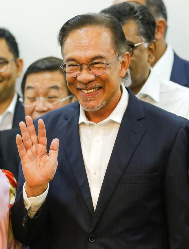 馬來西亞人民公正黨領袖安華26日宣布,希望聯盟決定推薦他成為總理人選。(歐新社)