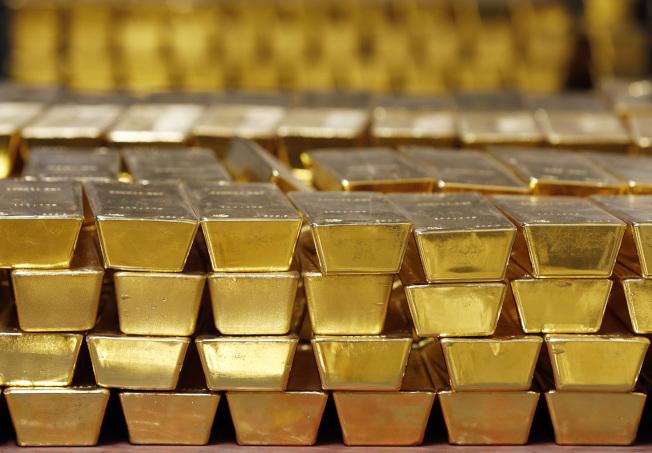 避險買盤今年湧向黃金資產。美聯社