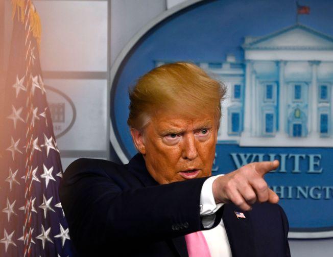 美國總統川普26日召開記者會宣布提升抗疫層級由副總統潘斯督導。Getty Images