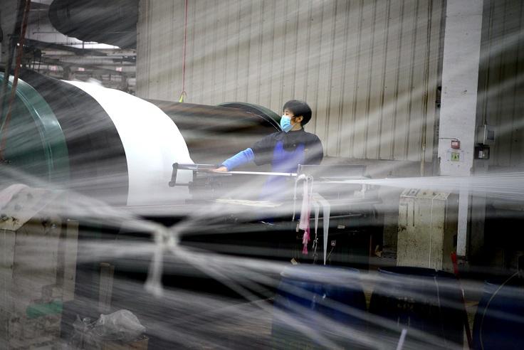 福建莆田金川村爆發群聚感染。圖為福建部分台資工廠已恢復開工。(中新社)