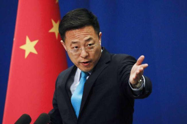 中國外交部發言人趙立堅12日在推特上質疑「可能是美軍把疫情帶到了武漢」。(美聯社)