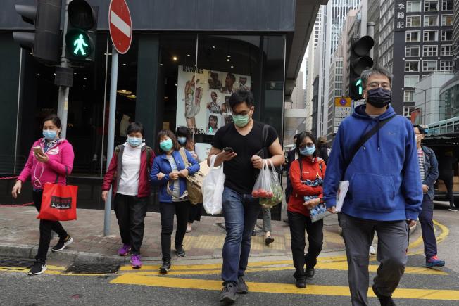 香港21日新增17宗新型冠狀病毒確診及20宗初步診確,累計個案逼近300宗。(美聯社)