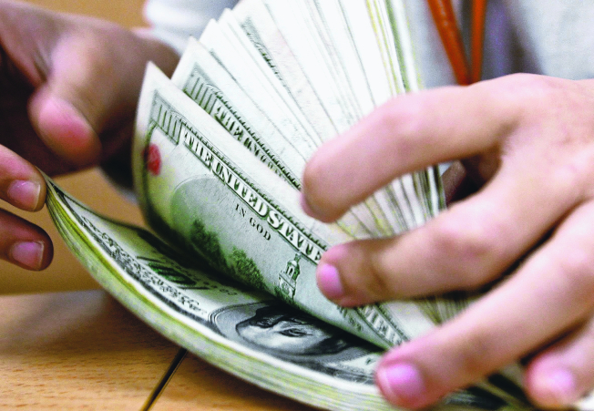 新型冠狀病毒襲擊美國經濟,有人因而失業,急需現金。(歐新社)