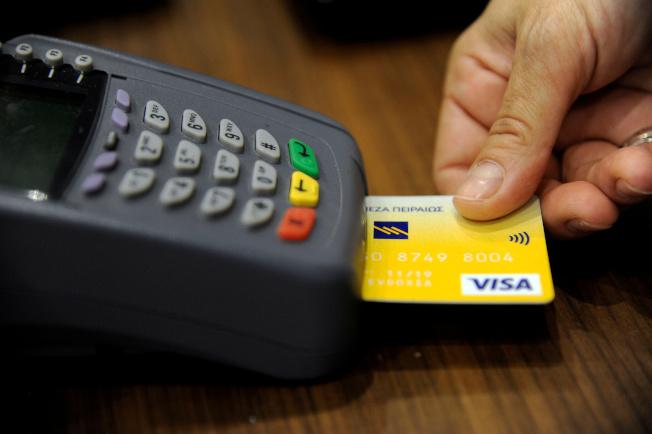 主要支付業者過去幾年幾乎取消所有刷卡簽名。(路透)