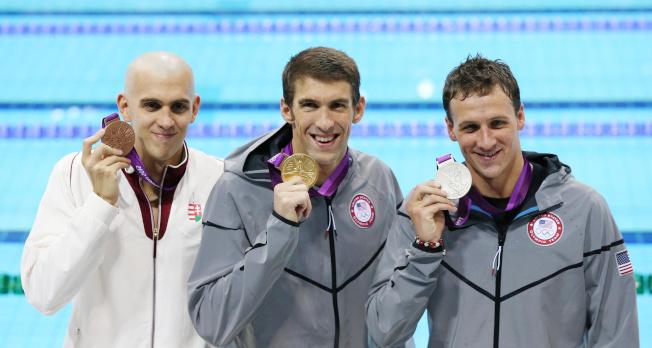 拉克提(右)是美國游泳史上最成功的選手之一。(路透社)