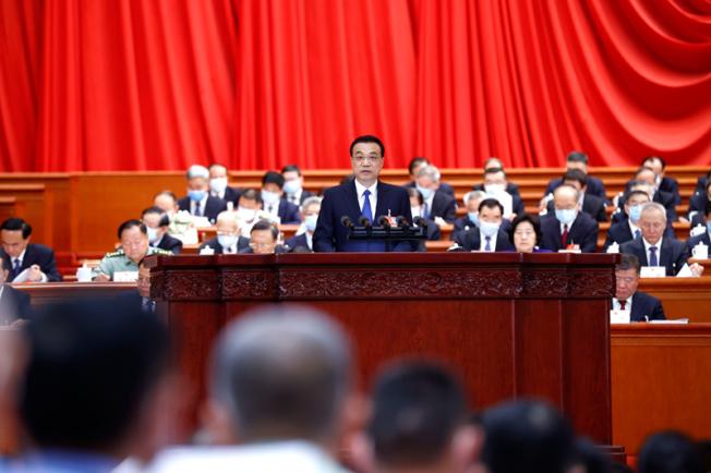 今年政府工作報告涉台部分沒有提九二共識、一國兩制,也沒有和平兩個字。(中國政府網)