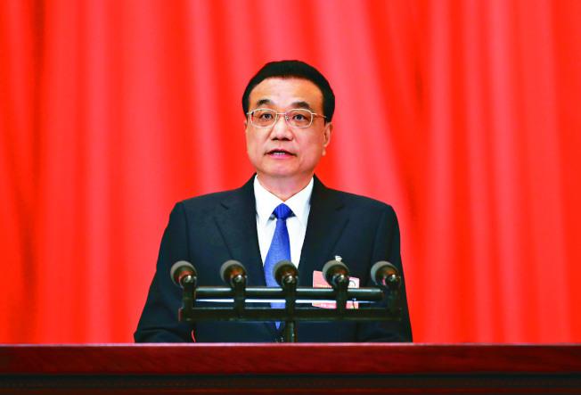 中國13屆全國人大三次會議22日在北京開幕,李克強總理作政府工作報告,6年第一次沒有提「九二共識」。(中新社)