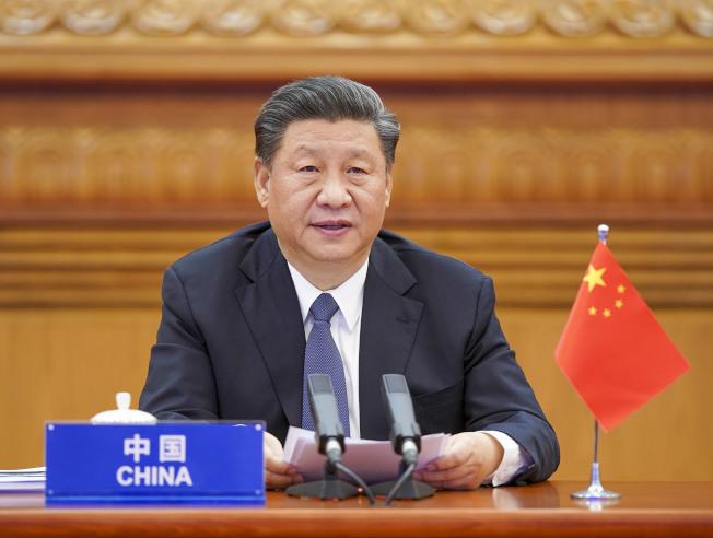 習近平在全國政協聯組會議上表示,中國身處的國際環境是「國際交往受限、經濟全球化遭遇逆流、地緣政治風險上升」。(新華社)